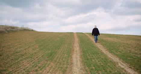 Agriculture-Female-Farmer-Walking-On-Agricultural-Field