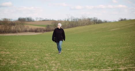 Agriculture-Female-Farmer-Walking-On-Agricultural-Field-3