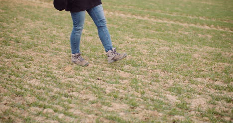 Agriculture-Female-Farmer-Walking-On-Agricultural-Field-4