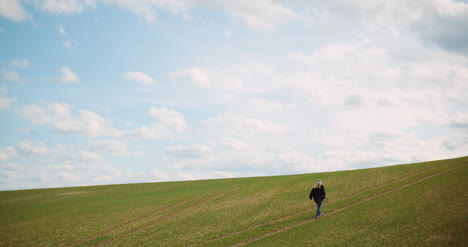 Agriculture-Female-Farmer-Walking-On-Agricultural-Field-6