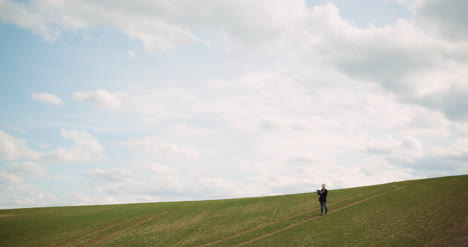 Agriculture-Female-Farmer-Walking-On-Agricultural-Field-7