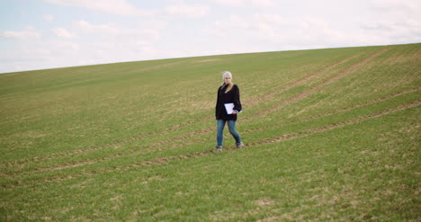 Agriculture-Female-Farmer-Walking-On-Agricultural-Field-9