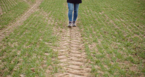Agriculture-Female-Farmer-Walking-On-Agricultural-Field-10