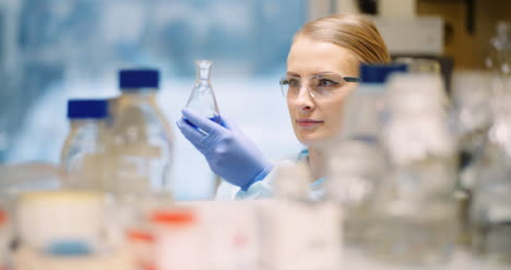Scientist-Mixing-Flask-At-Laboratory-In-Molecular-Biotechnology-Laboratory