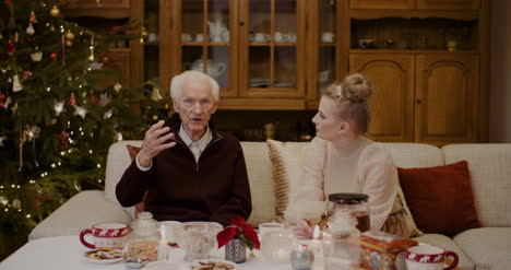 Woman-Talking-With-Grandfather-At-Home-During-Christmas