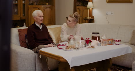 Woman-Talking-With-Grandfather-At-Home-During-Christmas-2