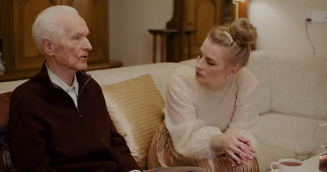 Woman-Talking-With-Grandfather-At-Home-During-Christmas-3