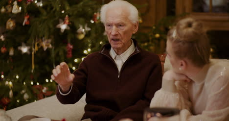 Woman-Talking-With-Grandfather-At-Home-During-Christmas-6