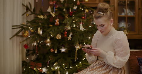 Woman-Using-Digital-Tablet-And-Shopping-Online-During-Christmas