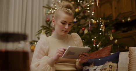 Woman-Using-Digital-Tablet-And-Shopping-Online-During-Christmas-5