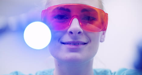 Dentist-Using-Uv-Hardener-During-Surgey-At-Healthcare-Clinic-1