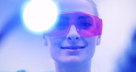 Dentist-Using-Uv-Hardener-During-Surgey-At-Healthcare-Clinic-4