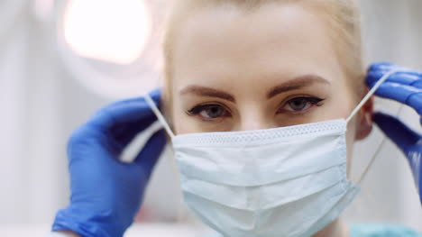 Dentist-Putting-On-Protective-Mask-Before-Surgery-4