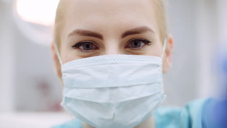 Close-Up-Of-Female-Dentist-Looking-At-Patient-During-Surgey-2