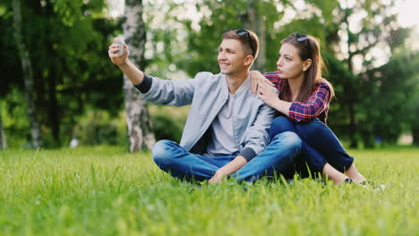 Young-Couple-Resting-In-A-Park-Makes-Selfie-Hd-Video