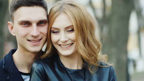 Man-And-Woman-20-25-Years-Smiling-Hugging-And-Very-Happy
