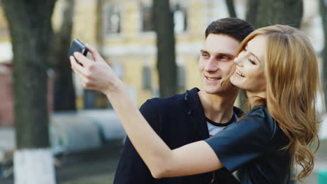 Hipster-Couple-Making-Funny-Selfie-In-The-City-Hd-Video