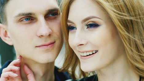 Portrait-Of-A-Young-Couple-20-25-Years-Look-Into-The-Distance-Smiling-Very-Happy