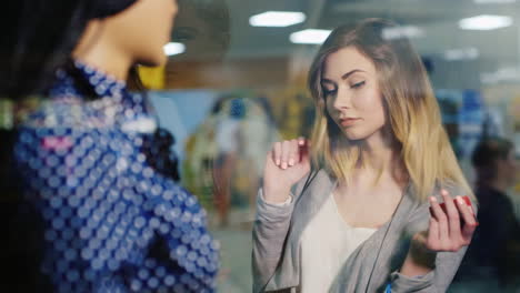Young-Attractive-Woman-Contemplates-Showcase-Clothing-Store-In-The-Hands-In-Her-Card-For-Shopping-An