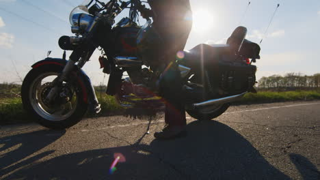 Biker-Sit-On-A-Motorcycle-And-Wears-A-Helmet-The-Sun-s-Rays-Shine-Into-The-Camera-Giving-Beautiful-R