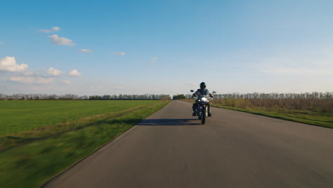 Biker-Rides-On-A-Rural-Road-Tractor-Rides-Past-Him-Hd-Video