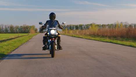 Motorcyclist-Riding-Along-A-Narrow-Asphalt-Road-Hd-Video
