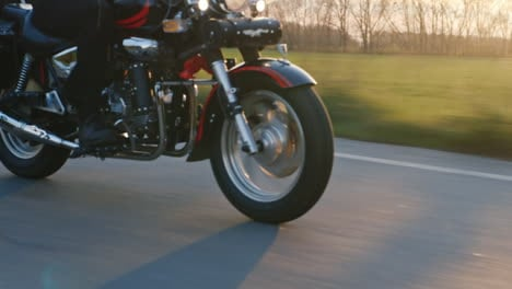 Motorcycle-Wheels-Which-Quickly-Goes-On-The-Road-The-Sun-Shines-And-Gives-A-Nice-Glare-Hd-Video