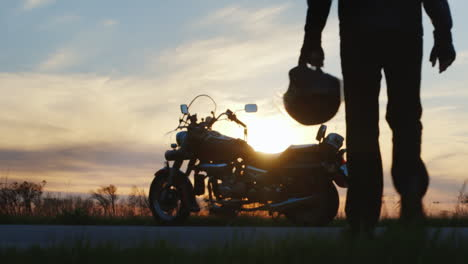 Silhouette-Of-Biker-At-Sunset-That-Goes-To-His-Motorcycle