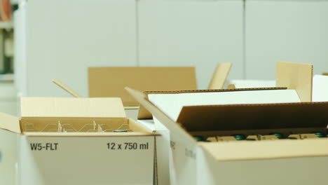 Worker-Packs-Wine-Bottles-in-Boxes