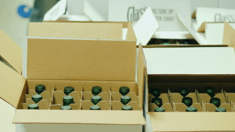 Workers-Pack-Wine-Bottles-in-Boxes