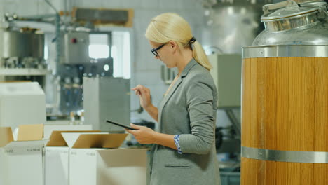 Woman-Checks-Inventory-With-Tablet