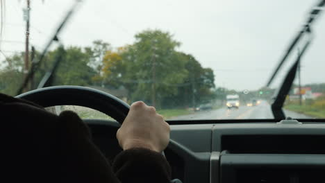 The-Driver-Drives-A-Car-On-Rainy-Day