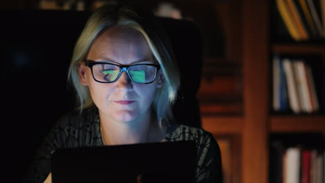 Woman-With-Tablet-in-Study-at-Night