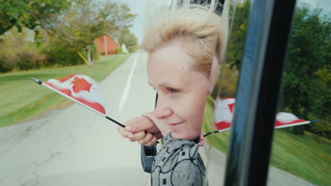 Woman-With-Canada-Flag-in-Car-Window
