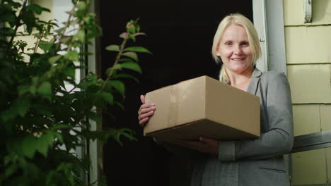 Happy-Woman-Holding-Parcel