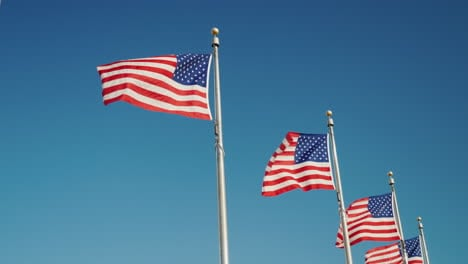 American-Flags-Against-Blue-Sky