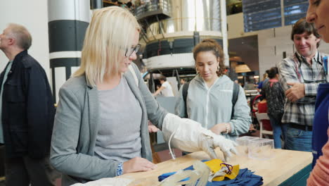 Woman-Tries-Out-Astronaut-Glove