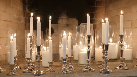 Candles-and-Candlesticks-in-Fireplace