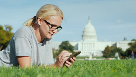 Woman-Using-Smartphone-by-Capitol-Building