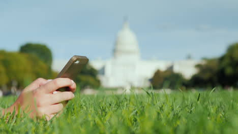 Hands-Use-Phone-By-Capitol-Building