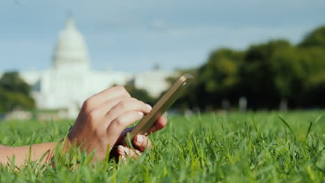 Woman-s-Hands-Use-Phone-By-Capitol-Building