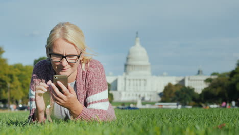 Woman-Using-Phone-by-Capitol-Building