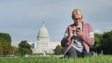 Woman-Uses-Phone-by-US-Capitol-Building
