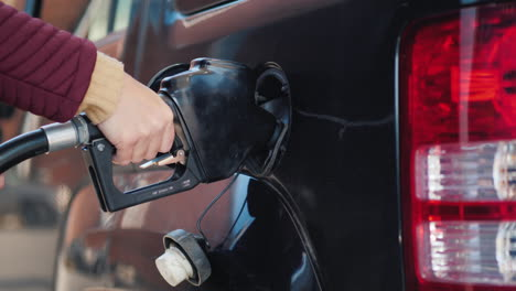 Pumping-Gas-Into-Black-Car