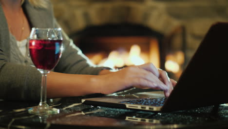 Woman-Working-on-Laptop-With-Wine