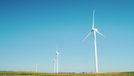 Wind-Turbines-Against-Blue-Sky