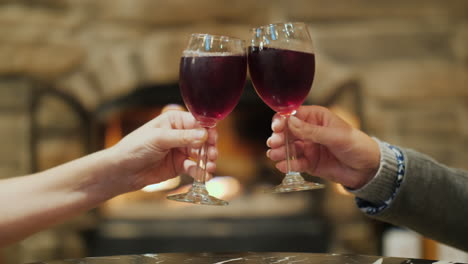 Toasting-With-Red-Wine-by-Fire