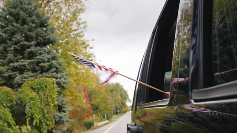 USA-Flag-Flying-From-Car-Window
