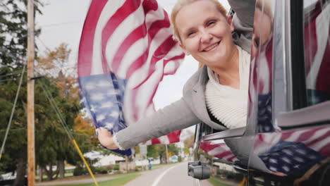 Woman-With-USA-Flag-Leans-Out-of-Car