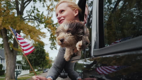 Woman-and-Dog-and-US-Flag-in-Car-Window